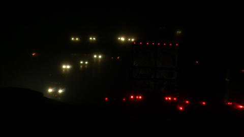 Headlights and taillights on busy highway at night (High... Stock Video Footage