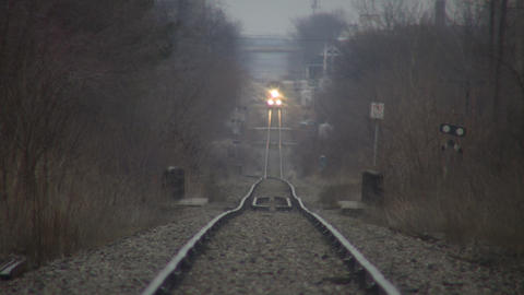 Timelapsed train moves down tracks as cars pass (High Definition) Footage