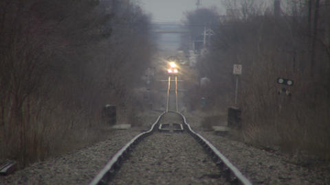 Timelapsed train moves down tracks as cars pass (High... Stock Video Footage