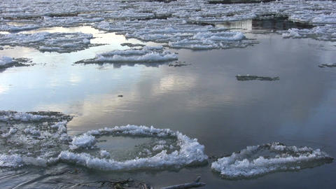 Ice drift in a river at sunset 7 Stock Video Footage