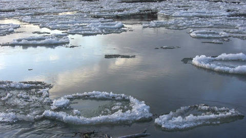 Ice drift in a river at sunset 7 Footage