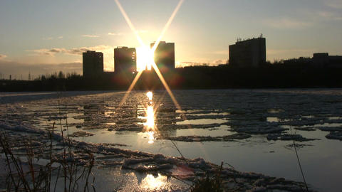 Ice drift in a river at sunset 14 Footage