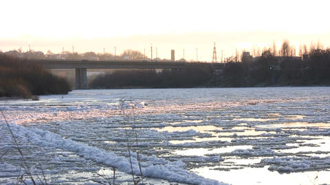 Ice drift in a river at sunset 17 Footage