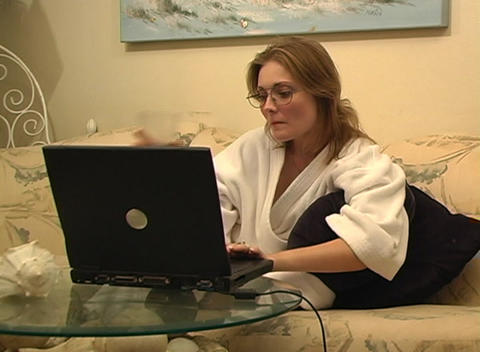 Beautiful Woman at Home with Laptop Stock Video Footage