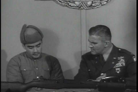 A narrator interviews a Chinese communist during t Footage