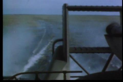 Navy troops use unique boats to patrol farmland fl Footage