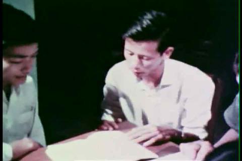 Members of the American military assist Vietnamese Footage