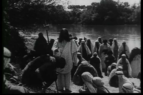 Jesus is baptized by John in this silent film Footage