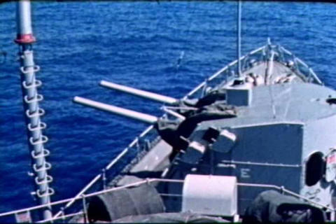 Naval crewmen perform an anti-aircraft drill and f Live Action