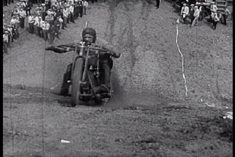 Motorcyclists attempt to climb a hill in Detroit d Footage