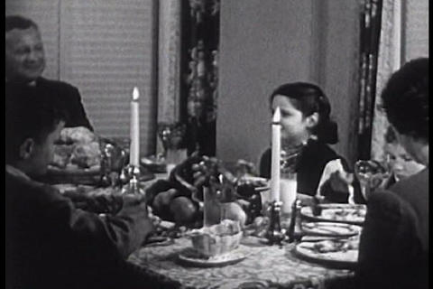 A family eats their Thanksgiving dinner during the Live Action