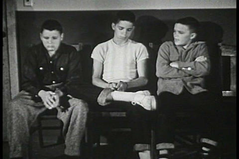 Three boys sit in front of the principal's office  Footage