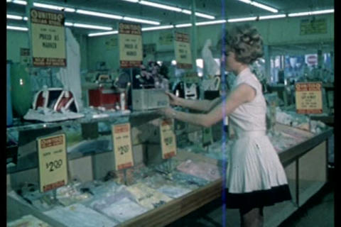 A woman browses through various items at a dollar  Live Action