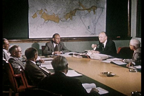 A classic 1950s factory has a board meeting during Footage
