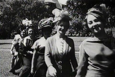Women wear fashionable hats in 1931 Footage
