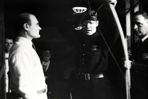 Policemen train in archery in 1934 Live Action