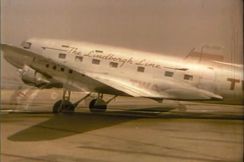 People disembark from an early commercial airline  Footage