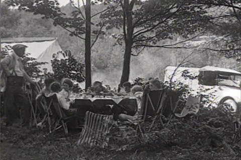 People go camping in 1921 Footage