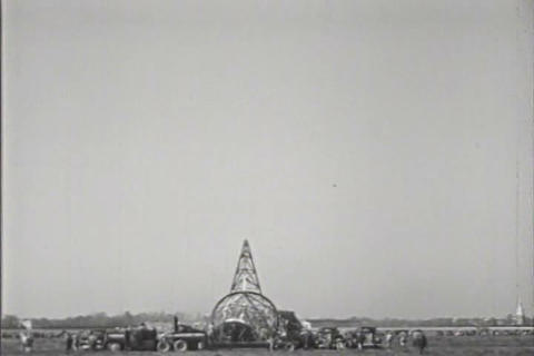 A tower is dismantled and brought to the ground in Footage