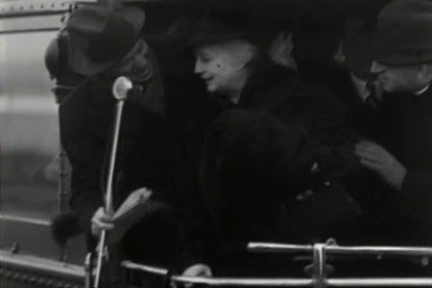 An unknown politician or dignitary (possibly Sam H Footage
