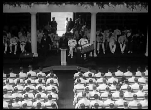 Calvin Coolidge speaks at Annapolis to the militar Live Action