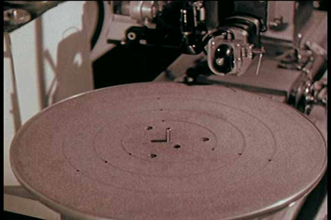 Sound engineers work on producing a stereo LP albu Live Action