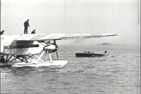 The Ford Tr-Motor airplane being tested on pontoon Footage