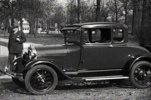 Irvin S. Cobb, humorist and writer, drives a Ford  Footage