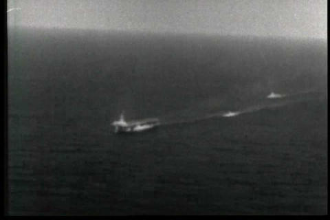 The U.S.S. Guadalcanal tows a German U boat on the Footage