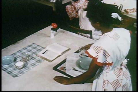 Home economics classes in the 1950s. Good classroo Footage