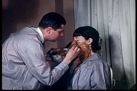 In the 1950s a man makes a plaster cast of a woman Live Action