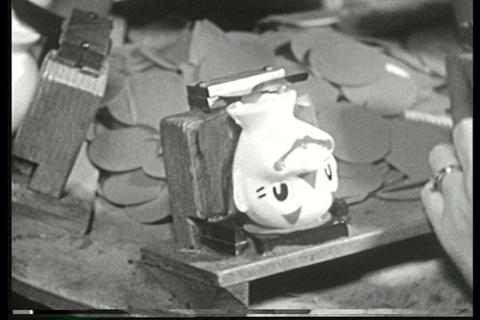 Assembly line workers make toys in a factory in th Footage