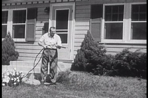 A Family In The 1950s Suburbs Treats Their Family  stock footage