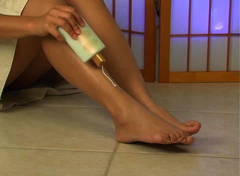 Applying Lotion to Legs (1) Stock Video Footage