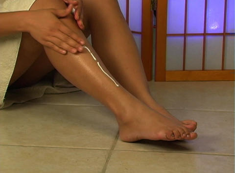 Applying Lotion to Legs (1) Footage