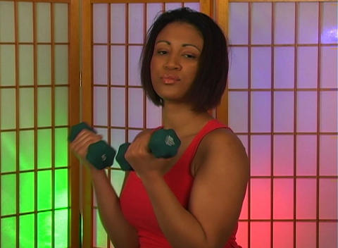 Lovely Young Woman with Hand Weights (2) Footage