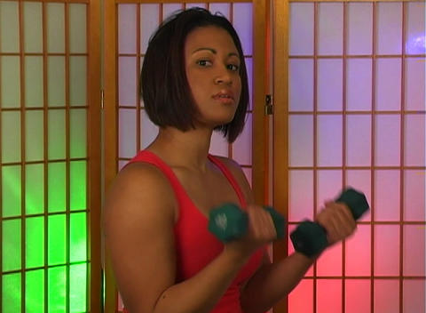 Lovely Young Woman with Hand Weights (2) Stock Video Footage