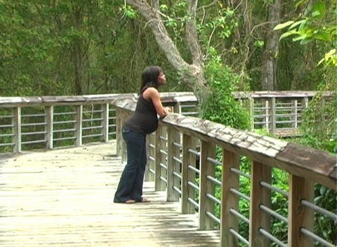 Beautiful Pregnant Woman Walking Outdoors (2) Stock Video Footage