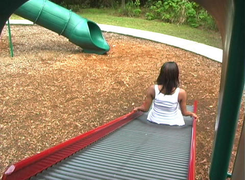 Beautiful Pregnant Woman on a Playground (6) Stock Video Footage