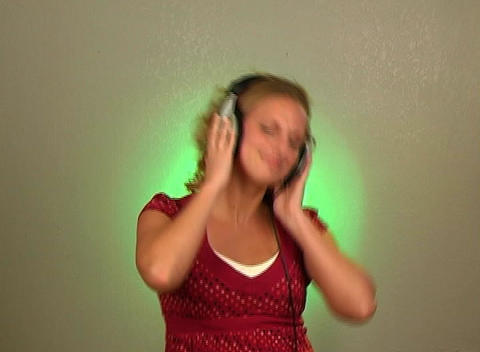 Beautiful Young Blonde Dances to the Music in Her Stock Video Footage