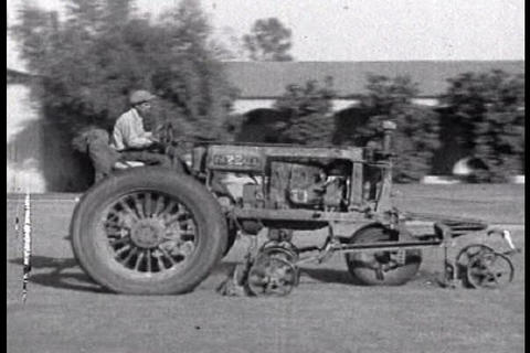 Men use tractors on the farm in 1920 Footage