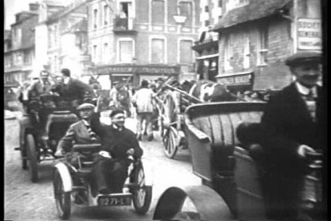 Old cars race slowly in Deauville, France, in 1930 Live Action