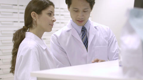Pharmacists Discussing In Pharmacy stock footage