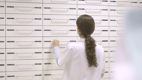 Female pharmacist working in pharmacy Footage