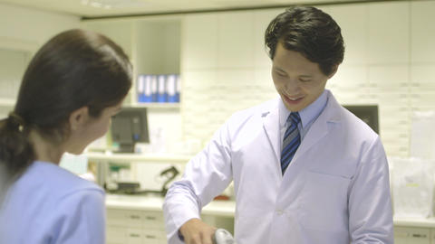Pharmacist giving medicine to patient Footage