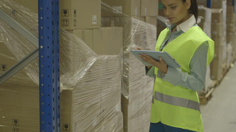Young woman engineer using digital tablet in factory Footage