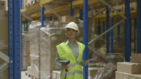 Woman Using Digital Digital Tablet In Logistics Wa stock footage