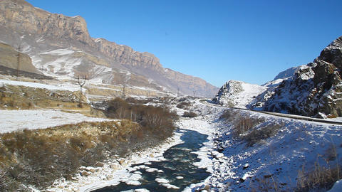 Fast, clean, mountain river flowing in the valley Footage