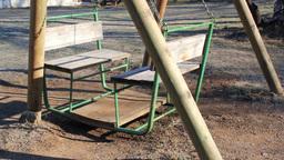 Swaying empty swing in a park Footage
