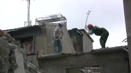 Workers use hammers to destroy old building in Sha Footage